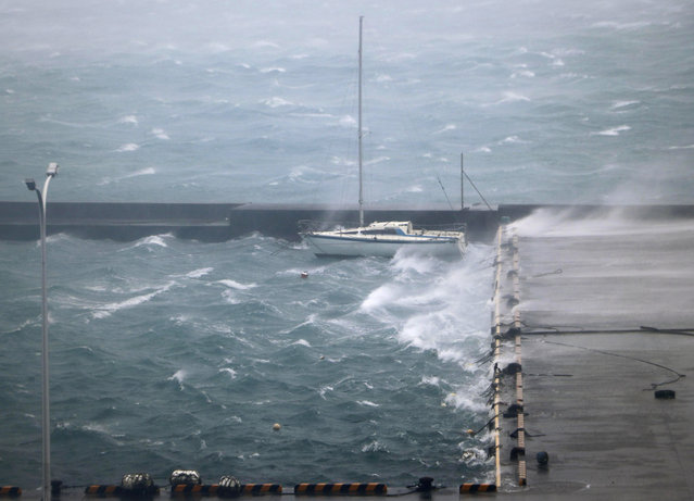 High waves pound a fishing port in Amami city, Kagoshima prefecture, southwestern Japan as a typhoon hits the region, Sunday, Septenber 6, 2020. (Photo by Kyodo News via AP Photo)