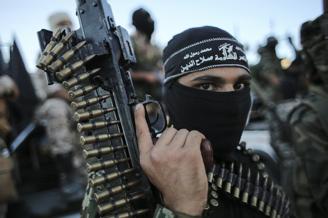 Palestinian militants from the Al-Nasser Brigades, an armed wing of the Popular Resistance Committees (PRC), hold their weapons during a rally in Rafah in the southern Gaza Strip on September 26, 2016, to mark the 16th anniversary of the creation of their group. (Photo by Said Khatib/AFP Photo)