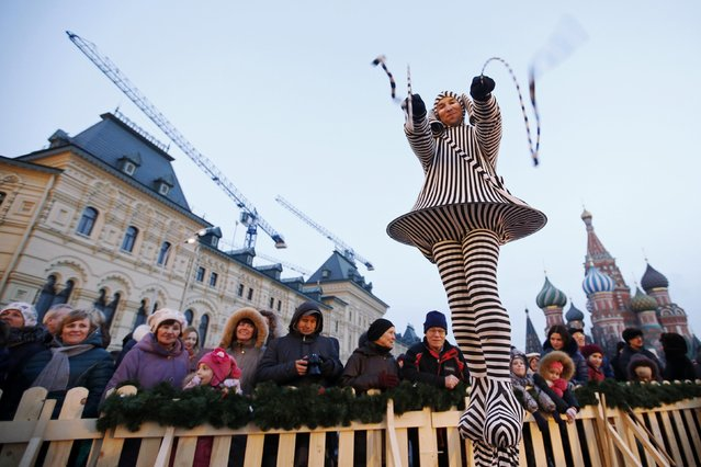 An artiste performs on the first day of a fair organized by GUM departmental store for the upcoming Christmas and New Year celebrations at Moscow's Red Square, November 29, 2014. (Photo by Maxim Zmeyev/Reuters)