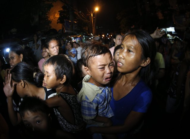 "A picture made available on 01 October 2016 shows Filipino mothers holding their babies as they check on their husbands, who were arrested after a drug buy-bust operation, at a slum area in Manila, Philippines, 30 September 2016. After comparing himself to Adolf Hitler, Philippine President Rodrigo Duterte said on September 30, that he wants to kill the three million drug addicts he claims reside in his country, in remarks made following his return from an official two-day trip to Vietnam. ""Hitler massacred three million Jews. Now, there are three million drug addicts... I'd be happy to slaughter them"", said Rodrigo Duterte before the press, according to an official transcript from his office. Criticism of the Philippines' violent war against drugs has been met with condemnation from Philippine President Rodrigo Duterte, who recently went on a tirade against the EU after the European Parliament expressed concern over the human rights situation on the island. (Photo by Francis R. Malasig/EPA)"