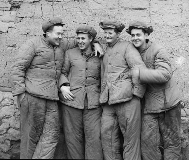 Frank Noel, Associated Press staff photographer, who has been a prisoner of war for more than a year, with the consent of his communist captors, took this picture of Americans held as war prisoners in camp no. 5 at Pyokdong, North Korea, February 1, 1952. Left to right , Jerry Oakley, Albany, Ore.; Clayton Rogers, Little Rock, Ark.; Charles Davis, Mount Vernon, Ill.; and Roland Hamilton. (Photo by Frank Noel/AP Photo)