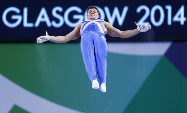 Frank Baines of Scotland performs his routine on the horizontal bar during the team apparatus final of the artistic gymnastics at the 2014 Commonwealth Games in Glasgow, Scotland, in this July 29, 2014 file photo. (Photo by Andrew Winning/Reuters)