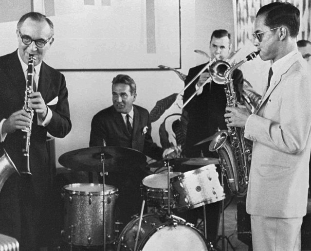 In this July 5, 1960, file photo, Thailand's King Bhumibol Adulyadej, right, plays the saxophone during a jam session with legendary jazz clarinetist Benny Goodman, left, drummer Gene Krupa, second left, and trombonist Urbie Green in New York. (Photo by Bureau of the Royal Household via AP Photo)