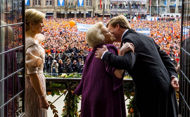 Princess Beatrix kisses her son King Willem-Alexander as Queen Maxima looks on during a short address on the balcony of the Royal Palace to greet the public after the abdication of Queen Beatrix, on April 30, 2013. (Photo by Jeroen Van Der Meyde/RVD/Getty Images)