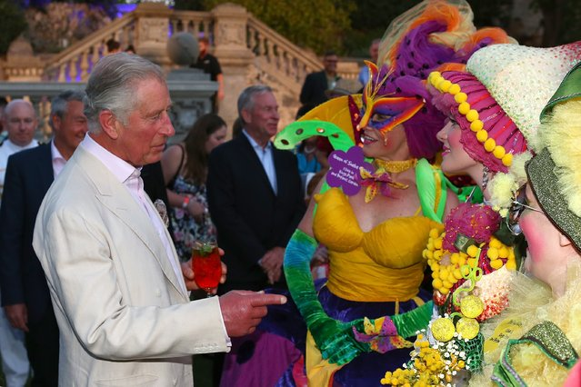 Prince Charles, Prince of Wales talks with entertainers as he attends a reception with Camilla, Duchess of Cornwall to celebrate the Prince's birthday at the Cottesloe Civic Centre on November 14, 2015 in Perth, Australia. The Royal couple are on a 12-day tour visiting seven regions in New Zealand and three states and one territory in Australia. (Photo by Paul Kane/Getty Images)