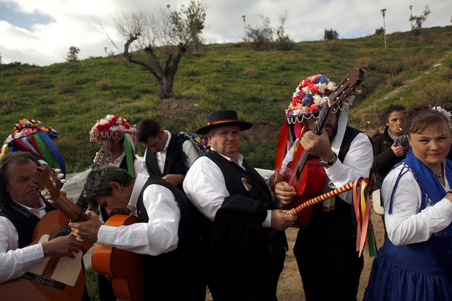 People in traditional costumes tune their instruments before competing in the 53rd Verdiales music contest in Malaga, southern Spain December 28, 2014. (Photo by Jon Nazca/Reuters)