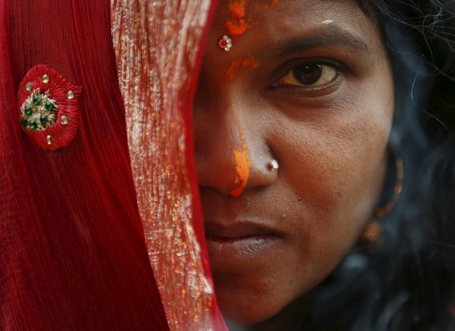 "A face of a devotee covered with her cloth is pictured as she offers prayers to the rising sun during the ""Chhat"" festival in Kathmandu, Nepal November 18, 2015. (Photo by Navesh Chitrakar/Reuters)"