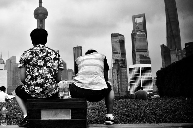 """""""Shanghai Tian Wai №17, 2014"""". The project takes its title from these two districts, on either bank of the Suzhou river: Tian refers to Tian Tong Lu, the name of a street that runs through this popular district under construction... (Photo by Liu Tao/The Guardian)"""