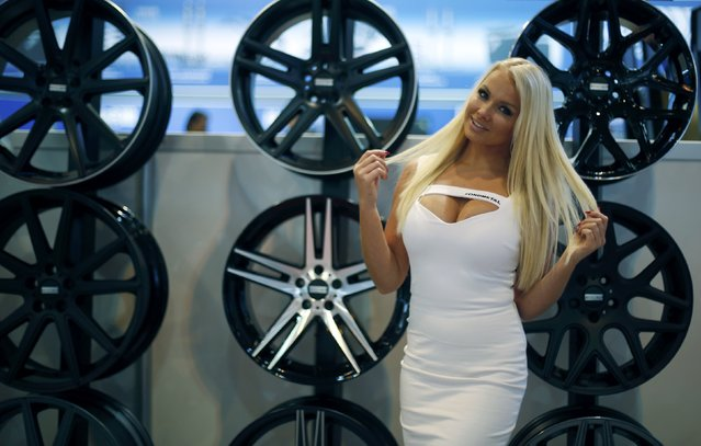 A model poses in front of car rims at the Essen Motor Show in Essen, Germany, November 27, 2015. (Photo by Ina Fassbender/Reuters)