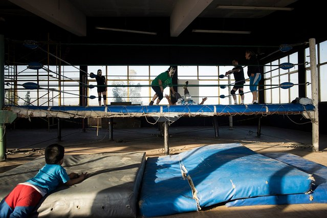 Wrestlers train in a gym in Mexico City. (Photo by Diana Bagnoli/The Washington Post)