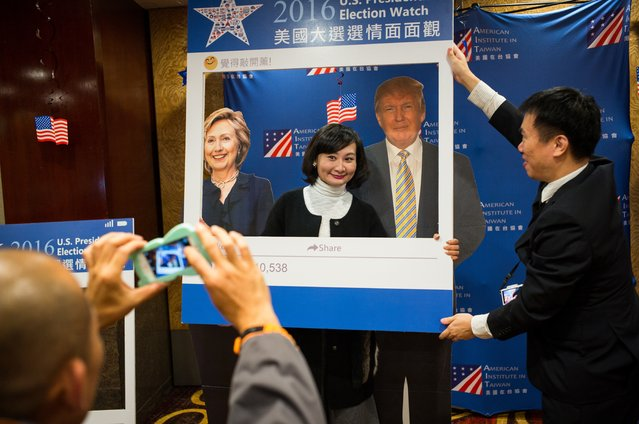 A woman poses for a photograph in front of cardboard cutouts of Democratic presidential nominee Hillary Clinton (L) and Republican presidential nominee Donald Trump (R) prior to watch a live broadcasting of the 2016 U.S. Presidential Election results> on November 9, 2016 in Taipei, Taiwan. Donald Trump defeated Democratic presidential nominee Hillary Clinton to become the 45th president of the United States. (Photo by Billy H.C. Kwok/Getty Images)