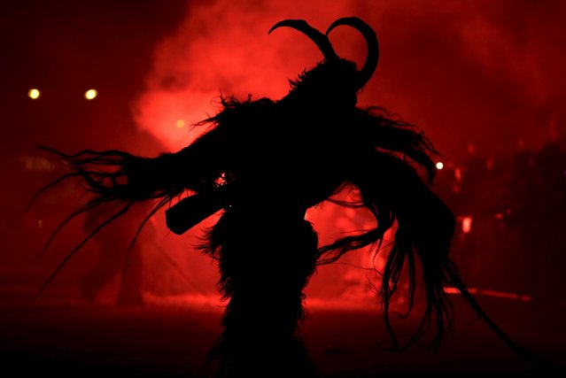 A man dressed as a devil performs during a Krampus show in the southern Bohemian town of Kaplice, December 12, 2015. (Photo by David W. Cerny/Reuters)