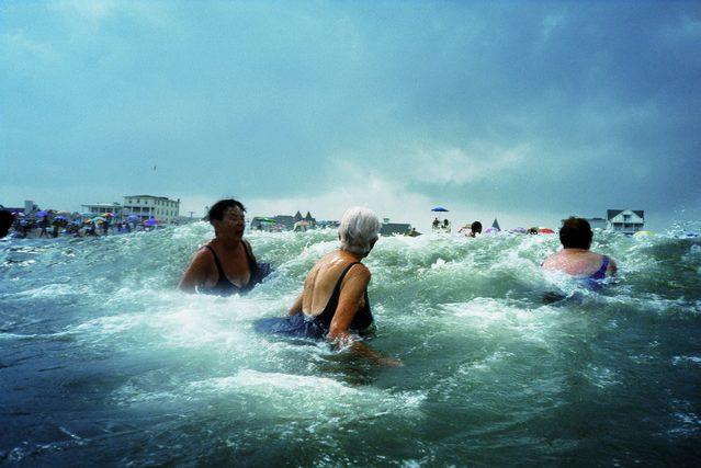 "Longtime Ocean Grove visitors take a dip in the roiling Atlantic surf in Ocean Grove, N.J., 2003. This image is featured in National Geographic's exhibition ""Women of Vision: National Geographic Photographers on Assignment"", on view at the Palm Beach Photographic Centre, Jan. 22 - Mar. 22, 2015. (Photo by Amy Toensing/National Geographic)"