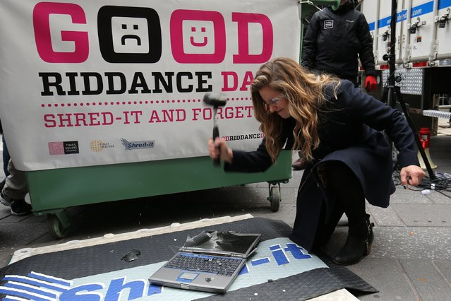 Host Alison Hagendorf takes part in the Good Riddance Day celebrations as part of the New Year's Eve 2016 run up in Times Square on December 28, 2015 in New York City. (Photo by Neilson Barnard/Getty Images)