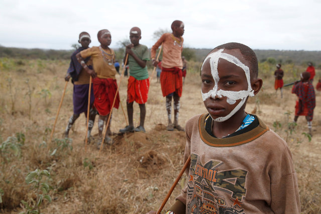 A Maasai boy stands during an initiation into an age group ceremony near the town of Bisil, Kajiado county, Kenya on August 23, 2018. (Photo by Baz Ratner/Reuters)