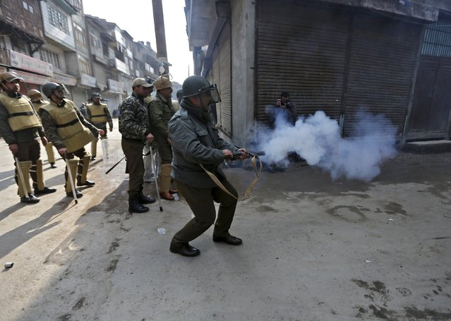 An Indian police officer fires teargas towards demonstrators during a protest in Srinagar, January 9, 2016. (Photo by Danish Ismail/Reuters)