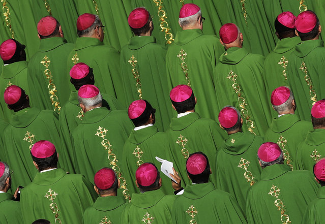 Bishops attend a Mass celebrated by Pope Francis for the opening of a synod in St. Peter's Square, at the Vatican, Wednesday, October 3, 2018. The synod (council) is bringing together 266 Roman Catholic bishops from five continents for talks on helping young people feel called to the church at a time when church marriages and religious vocations are plummeting in much of the West. (Photo by Alessandra Tarantino/AP Photo)
