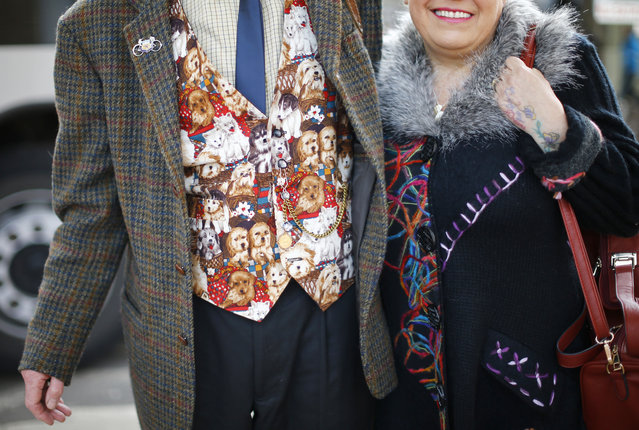 A man wearing a dog print waistcoat arrives for the first day of the Crufts Dog Show in Birmingham, central England, March 5, 2015. (REUTERS/Darren Staples)