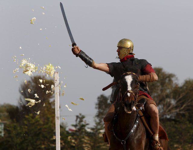 A member of the Fort Rinella Horse Troop of the Malta Heritage Trust rides take part in a display of ancient Roman army life at Fort Rinella in Kalkara, outside Valletta, March 22, 2015. (Photo by Darrin Zammit Lupi/Reuters)