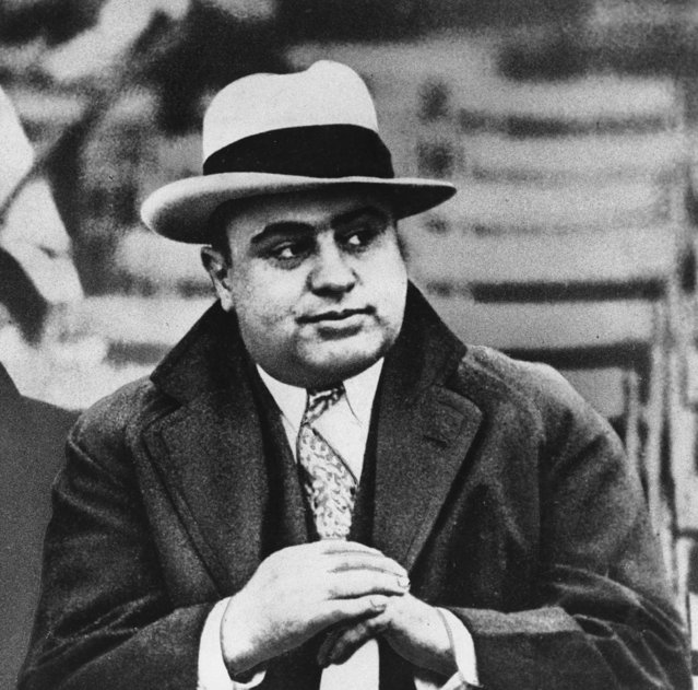 "This January 19, 1931 file photo shows Chicago mobster Al Capone at a football game. An intimate letter he penned from prison suggests the ruthless racketeer had a soft side. The three-page letter, which is to be auctioned next week in Cambridge, Mass., is addressed to Capone's son, Albert ""Sonny"" Capone. The mobster signed it, ""Love & Kisses, Your Dear Dad Alphonse Capone #85"", which was his number at the Alcatraz prison in San Francisco Bay. (Photo by AP Photo)"