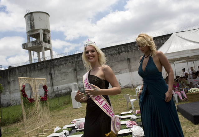 Inmate Veronica Verone, 25, left, smiles after she was crowned Miss Talavera Bruce 2018, at the penitentiary the beauty pageant is named for, in Rio de Janeiro, Brazil, Tuesday, December 4, 2018. Authorities say they organize the pageant, which attracts a lot of local media attention, to help the prisoners with their self-esteem and promote integration between them. (Photo by Silvia Izquierdo/AP Photo)