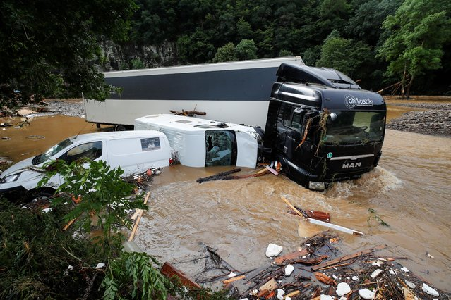 Partially submerged vehicles are pictured on a flood-affected area, following heavy rainfalls in Schuld, Germany, July 15, 2021. (Photo by Wolfgang Rattay/Reuters)