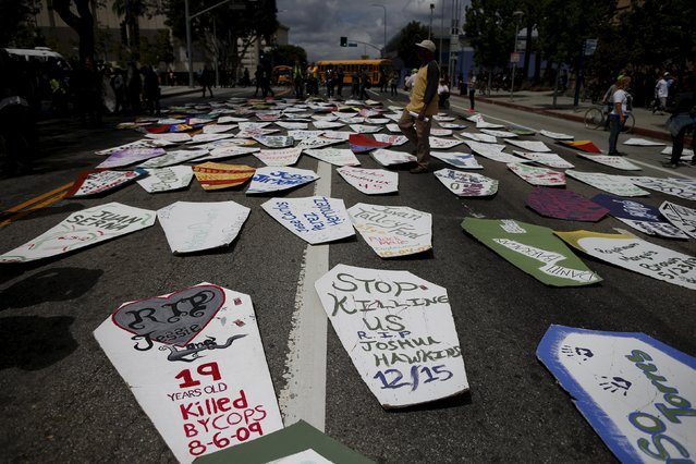 Cardboard coffins lay in the middle of the road during a march to commemorate the more than 617 people march organizers say have been killed by law enforcement in LA County since 2000, in Los Angeles, California April 7, 2015. (Photo by Lucy Nicholson/Reuters)