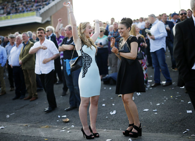 Horse Racing – Crabbie's Grand National Festival – Aintree Racecourse April 9, 2015: Racegoers react during the first day. (Photo by Darren Staples/Reuters)