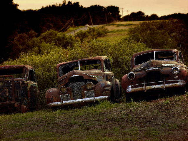 The three cars have rusted over time, in 2014, Oklahoma. (Photo by Dieter Klein/Barcroft Media)
