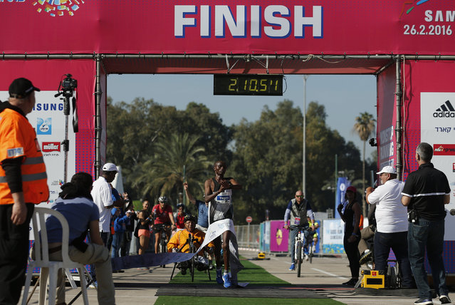 William Kiprono Yegon of Kenya crosses the finish line to win a marathon in Tel Aviv, Israel February 26, 2016. (Photo by Amir Cohen/Reuters)