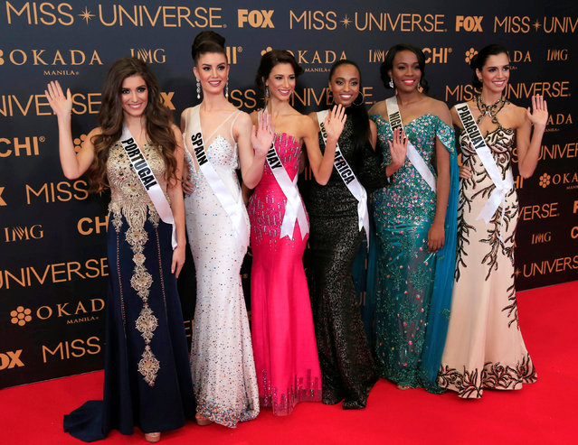 Miss Universe candidates gestures for a picture during a red carpet inside a SMX convention in metro Manila, Philippines January 29, 2017. In Photo from L-R: Miss Portugal Flavia Brito, Miss Spain Noelia Freire, Miss Uruguay Magdalena Cohendet, Miss South Africa Ntandoyenkosi Kunene, Miss Nigeria Unoaku Anyadike and Miss Paraguay Andrea Melgarejo. (Photo by Romeo Ranoco/Reuters)