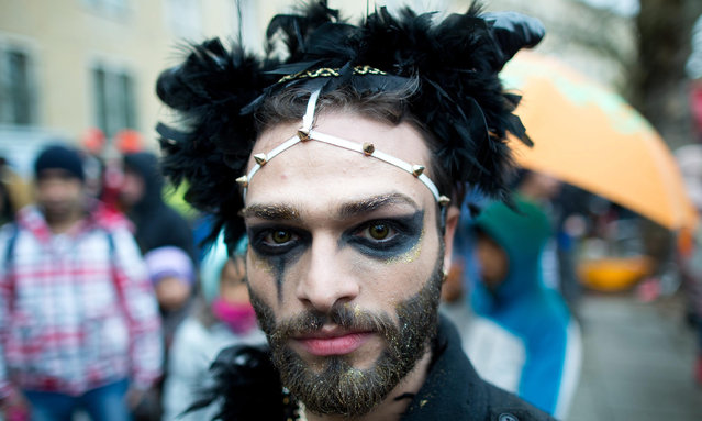 """Michael from Syria takes part in the """"Carnival Al-Lajiin_Al-Lajiaat / Carnival of Refugees"""" in Berlin, Germany, 20 March 2016. A Berlin-based alliance had called for the parade, a day ahead of the International Day for the Elimination of Racial Discrimination. (Photo by Joerg Carstensen/EPA)"""