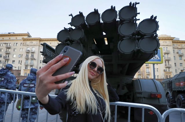 Russian woman takes selfie near military vehicle during the rehearsal for a military parade in Moscow, Russia, 29 April 2019. Russia will hold a Victory Day military parade on 09 May 2019 to mark the 74th anniversary since the capitulation of Nazi Germany in 1945. (Photo by Yuri Kochetkov/EPA/EFE)