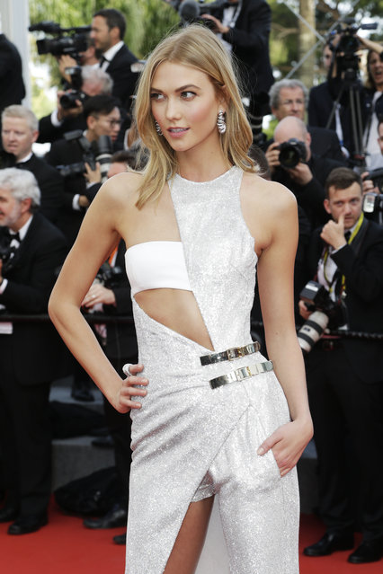 Model Karlie Kloss poses for photographers as she arrives for the opening ceremony and the screening of the film La Tete Haute (Standing Tall) at the 68th international film festival, Cannes, southern France, Wednesday, May 13, 2015. (Photo by Thibault Camus/AP Photo)