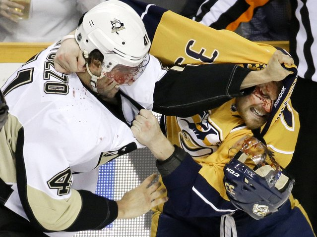 Pittsburgh Penguins defenseman Robert Bortuzzo (41) fights with Nashville Predators forward Colin Wilson (33) in the first period of an NHL hockey game Tuesday, March 4, 2014, in Nashville, Tenn. (Photo by Mark Humphrey/AP Photo)