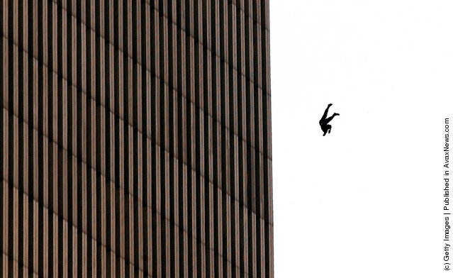 A man fall to his death from the World Trade Center after two planes hit the building September 11, 2001 in New York City