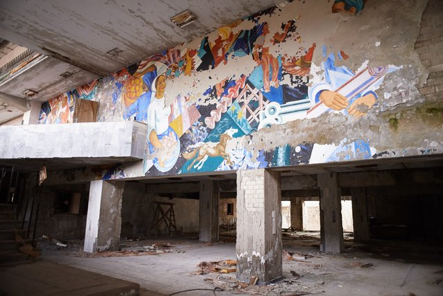 "Wall painting in abandoned the building of culture ""Energetic"" in the Pripyat, near the Chernobyl nuclear power plant in the Exclusion Zone, Ukraine, April 5, 2017. (Photo by Vitaliy Holovin/Corbis via Getty images)"