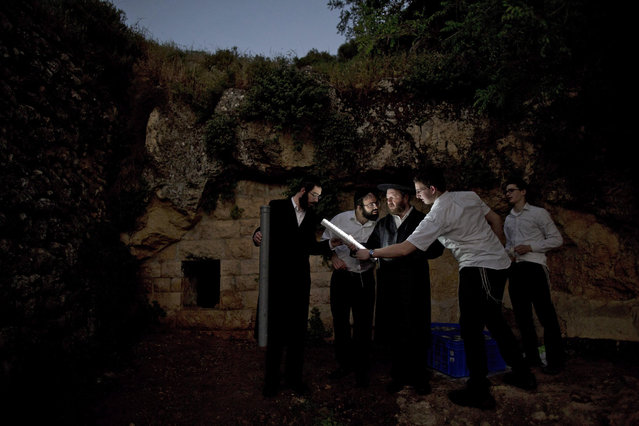 Ultra-Orthodox Jews collect water from a mountain spring outside Jerusalem, Israel, 11 April 2016. The week-long Jewish holiday of Passover, commemorates the Jewish exodus from Egypt in Biblical times. (Photo by Abir Sultan/EPA)