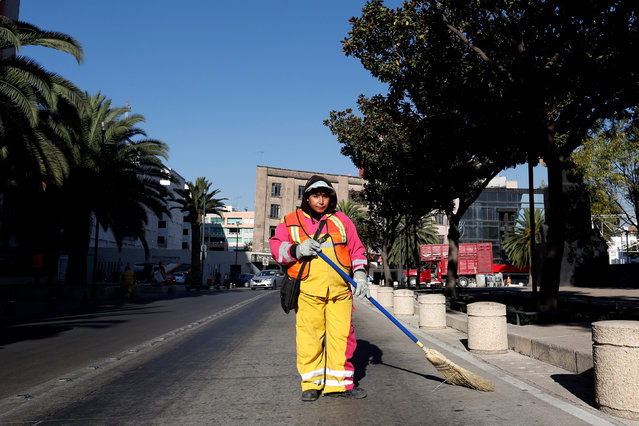 """Jauna Diaz, 43, a street sweeper, poses for a photograph as she woks on the street in Mexico City, Mexico, February 26, 2017. """"In my previous job my boss gave preference to male colleagues and women always were paid later. ThatÕs why I changed jobs"""", Diaz said. """"To tackle gender inequality I think there needs to be more communication and information about women's rights in the work place"""". (Photo by Carlos Jasso/Reuters)"""