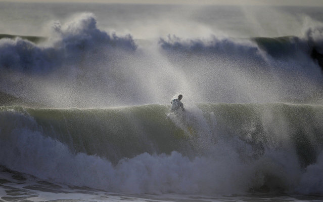 A bodyboarder rides a wave during Sumol Nazare Special Edition in Nazare March 20, 2014. The event started 10 years ago and gathers bodyboarders from different countries. (Photo by Rafael Marchante/Reuters)