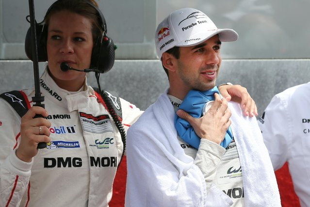Porsche No18 Swiss driver Neel Jani refreshs himself before the start of the 83rd 24-hour Le Mans endurance race, in Le Mans, western France, Saturday, June 13, 2015. (AP Photo/David Vincent)