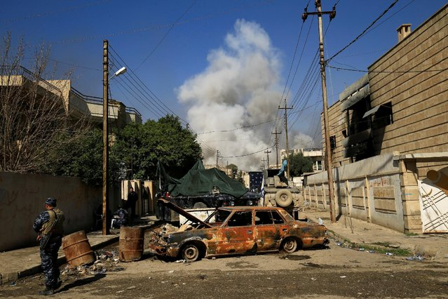 Smoke rises from a car bomb that exploded during a battle with Islamic State militants in Mosul, Iraq, March 6, 2017. (Photo by Thaier Al-Sudani/Reuters)