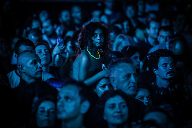 Festival-goers react during the concert of Scottish band Mogwai on the first day of 2019 Alive Festival in Oeiras, outskirts of Lisbon, Portugal, 11 July 2019. The festival runs from 11 to 13 July. (Photo by Mario Cruz/EPA/EFE)