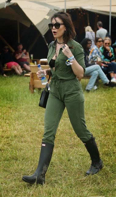 Model Daisy Lowe walks backstage at Glastonbury Music Festival on Friday, June 26, 2015 at Worthy Farm, Glastonbury, England. (Photo by Joel Ryan/Invision/AP Photo)