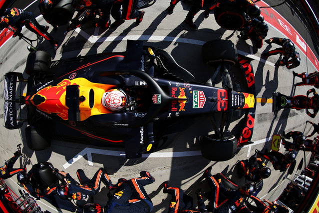Max Verstappen of the Netherlands driving the (33) Aston Martin Red Bull Racing RB15 makes a pitstop for new tyres during the F1 Grand Prix of Hungary at Hungaroring on August 04, 2019 in Budapest, Hungary. (Photo by Mark Thompson/Getty Images)