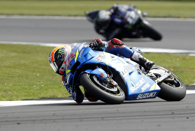 Spain's rider Alex Rins of the Team SUZUKI ECSTAR steers his motorcycle followed by Spain's rider Maverick Vinales of the Monster Energy Yamaha MotoGP during the MotoGP race at the British Motorcycle Grand Prix at the Silverstone racetrack, in Silverstone, England, Sunday, August 25, 2019. (Photo by Rui Vieira/AP Photo)