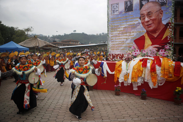 Tibetans dance as they celebrate the 80th birthday of their spiritual leader, the Dalai Lama, in Kathmandu, Nepal, Monday, July 6, 2015. (Photo by Niranjan Shrestha/AP Photo)