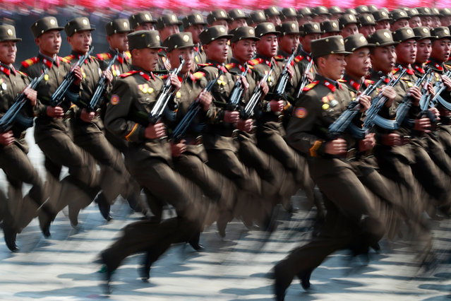 "North Korean soldiers march during a parade for the ""Day of the Sun"" festival on Kim Il Sung Square in Pyongyang, North Korea, 15 April 2017. (Photo by How Hwee Young/EPA)"