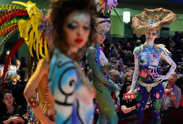 "Models wait for the rating of the jury during the ""Body Painting"" contest of the OMC Hairworld World Cup on May 4, 2014 in Frankfurt am Main, Germany. (Photo by Thomas Lohnes/Getty Images)"