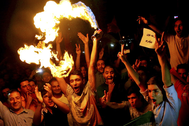 Iranians celebrate following a landmark nuclear deal in Tehran, Iran, Tuesday, July 14, 2015. (Photo by Ebrahim Noroozi/AP Photo)